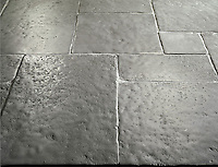Solid Limestone Tiles with hand-cut edge, partially bush hammered surface and consumed natural undulated, time worn finish. Shown in grey. Please call for color and size availability.