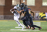 College Park, MD - October 22, 2016: Michigan State Spartans running back LJ Scott (3) gets tackled by several Maryland Terrapins defenders during game between Michigan St. and Maryland at  Capital One Field at Maryland Stadium in College Park, MD.  (Photo by Elliott Brown/Media Images International)