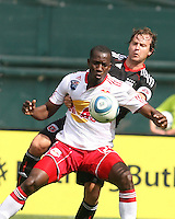 Carey Talley #8 of D.C. United is shielded from the ball by Ibrahim Salou #29 of the New York Red Bulls during an MLS match on May 1 2010, at RFK Stadium in Washington D.C.
