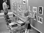 Looking at photos of the neighbourhood displayed at the Education Centre, Wester Hailes, Scotland, 1979.  John Walmsley was Photographer in Residence at the Education Centre for three weeks in 1979.  The Education Centre was, at the time, Scotland's largest purpose built community High School open all day every day for all ages from primary to adults.  The town of Wester Hailes, a few miles to the south west of Edinburgh, was built in the early 1970s mostly of blocks of flats and high rises.