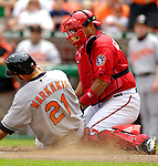 21 May 2006: Wiki Gonzalez, catcher for the Washington Nationals, tags Nick Markakis out at the plate during a game against the Baltimore Orioles at RFK Stadium in Washington, DC. The Nationals defeated the Orioles 3-1 to take 2 of 3 games in their first inter-league series...Mandatory Photo Credit: Ed Wolfstein Photo..