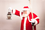 An Old Fashioned Santa Claus with a lantern and staff