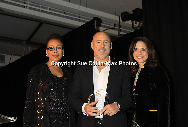 """Jeffrey Westphal honored with Hearts of Gold Angel Award by CNN's Soledad O'Brien and ATWT Tamara Tunie (co-mistresses of ceremonies) at Hearts of Gold's 16th Annual Fall Fundraising Gala & Fashion Show """"Come to the Cabaret"""", a benefit gala for Hearts of Gold on November 16, 2012 at the Metropolitan Pavilion, New York City, New York.   (Photo by Sue Coflin/Max Photos)"""
