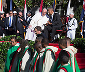 United States President Barack Obama and Pope Francis  chat while the choir of St. Augustine Catholic Church of Washington, DC  assembles on the South Lawn of the White House in Washington, DC during an Official State Welcome ceremony on Wednesday, September 23, 2015.  <br /> Credit: Chris Kleponis / CNP