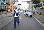 With a police officer clearing traffic for them, Christians from Japan and around the world joined together in a joint Anglican-Catholic march to the Catholic Memorial Cathedral for World Peace in Hiroshima, Japan, on August 5, 2015, as part of the commemoration of the 70th anniversary of the U.S. dropping an atomic bomb on the Japanese city of Hiroshima. Among the marchers were church leaders from seven countries that possess or claim to be protected by nuclear weapons. They came to Japan to listen to atomic bomb survivors and push for a world free of nuclear weapons.