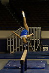 The number 25 ranked UK Wildcats gymnastics team competed in an intra-squad blue vs white scrimmage Thursday evening at Memorial Coliseum. Events included the balance beam (pictured here), the uneven bars, vault, and floor routine.  in Lexington, Ky., on Thursday, December, 6, 2012. Photo by James Holt | Staff