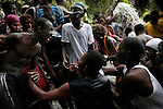Saut d'Eau, Haiti July 14-19, 2010  Every year, thousands of Haitians flock to Ville-Bonheur in Haiti for the July 16 feast of Our Lady of Mount Carmel. According to legend, the Virgin Mary showed herself in the mid-1800s on a tree near the waterfall. Every year since, Haitians make the pilgrimage to the waterfall to be blessed in the sacred water. July 2010 was no exception. Following the devastating magnitude-7.0 earthquake that hit the country in January 2010, the prayers were many.