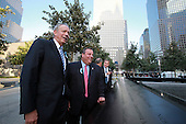 On the 10th anniversary of the September 11th attacks, former Governor George Pataki (Republican of New York) and current Governor Chris Christie (Republican of New Jersey) at the North Pool at the September 11th Memorial at the World Trade Center site in New York, New York on September 11, 2011. .Credit: Jefferson Siegel / Pool via CNP