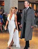 Washington,DC - April 26, 2008 -- Pamela Anderson arrives at the Washington Hilton Hotel in Washington, D.C. on Saturday, April 26, 2008 for the annual White House Correspondents Association (WHCA) Dinner.  With Ms. Anderson at right is Dan Mathews, Senior Vice President of the People for the Ethical Treatment of Animals (PETA)..Credit: Ron Sachs / CNP.(RESTRICTION: NO New York or New Jersey Newspapers or newspapers within a 75 mile radius of New York City)
