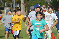 Fourth and fifth grade students run laps at Virginia Avenue Park during  Edison Language Academy 's  Jog-a-thon on Wednesday, February 29, 2012.