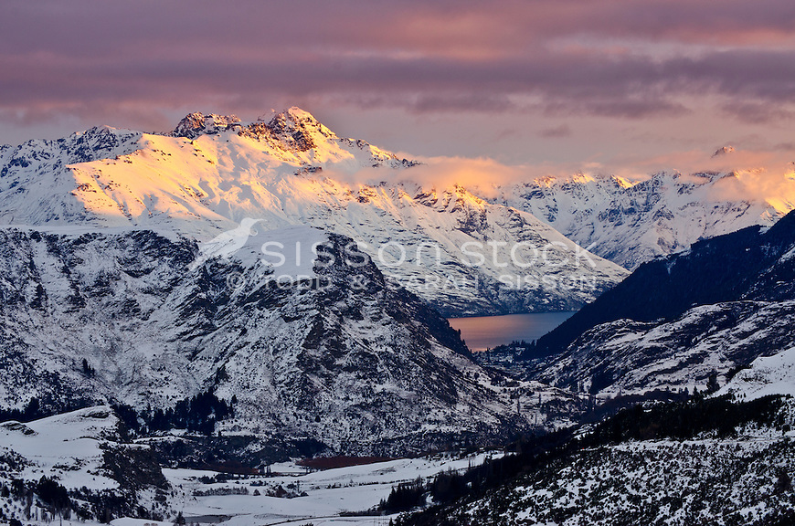 Sunset in winter on Walter and Cecil Peaks, Queenstown, seen from Coronet Peak road, South Island, New Zealand.