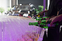 Moscow, Russia, 23/10/2009..Waiters pour champagne at the Millionaire Fair in Moscow. The event has become an annual fixture, attracting thousands of would-be and existing Russian millionaires to view and purchase a wide range of luxury goods. This year however the fair was much smaller, an indication of how the formerly booming Russian economy has been hit by the world financial crisis.