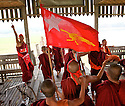 A group of monks celebrates on a teak bridge in U Bein the eleectoral victory. Myanmar, 2012.