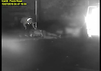 BNPS.co.uk (01202 558833)<br /> Pic: DorsetPolice/BNPS<br /> <br /> An unknown person raced up to the apparently lifeless Jacek Szafranski after he landed on the kerb...<br /> <br /> This is the shocking moment a cyclist was thrown through the air like a rag doll after a teenage driver crashed into him before speeding off.<br /> <br /> CCTV footage captured the horrifying moment victim Jacek Szafranski somersaulted 10ft before landing in the road.<br /> <br /> The video then shows him lying motionless on the ground as callous Benjamin George, 19, drives away without stopping to check on his 34-year-old victim.<br /> <br /> A court heard the horrific collision happened at the end of a five hour course of wreckless driving by George in Bournemouth, Dorset.<br /> <br /> He drove the wrong way down a dual carriageway in a Vauxhall Tigra, jumped through red lights, dangerously overtook multiple cars, almost lost control on a roundabout and nearly struck a pedestrian as he ran a red light in the space of two and a half hours.