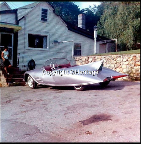 BNPS.co.uk (01202 558833)<br /> Pic: Heritage/BNPS<br /> <br /> ***Plase Use Full Byline***<br /> <br /> A photo of the original car before being painted, outside the Robinson family barn.<br /> <br /> The world's first Batmobile has emerged for sale for a whopping &pound;300,000 after being rescued from a field where it spent almost 50 years languishing.<br /> <br /> Batman's famous car was built more than 50 years ago from a 1956 Oldsmobile 88 that was converted to look just like the one from the comic books which made the Caped Crusader famous.<br /> <br /> It is a far cry from the Batmobile that appeared in Christopher Nolan's modern remakes of Batman.<br /> <br /> But as the first Batmobile ever built, experts at Dallas-based Heritage Auctions say it could sell for as much as $500,000 - more than &pound;300,000.