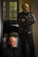 Billy Joel in front of his Steinway Hall portrait at Steinway &amp; Sons