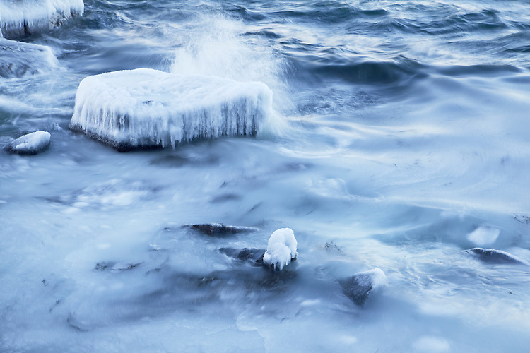 Grease ice coats the waves along the Schoodic Peninsula in winter in Acadia National Park, Maine, USA