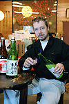 Master sake brewer Philip Harper from the United Kingdom pours himself a cup of sake at the Tamagawa Sake Brewery in Kyoto, Japan. . Photographer: Robert Gilhooly