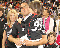 Jaime with youngest daughter as his wife aand other daughter look towards him during festivities surrounding the final appearance of Jaime Moreno in a D.C. United uniform, at RFK Stadium, in Washington D.C. on October 23, 2010. Toronto won 3-2.