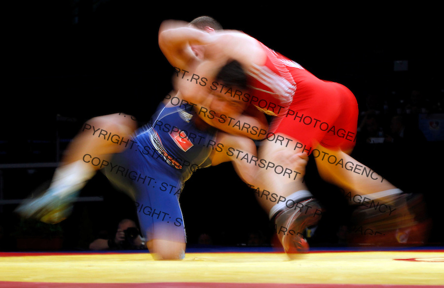 BELGRADE, SERBIA - MARCH 09: Long time exposure of Serdar Boke of Turkey (L) competes for the bronze medal with Gheorghita Stefan of Romania (R) of Men's Freestyle 84kg during the European wrestling championship March 09, 2011 in Belgrade, Serbia.(Photo by Srdjan Stevanovic/Getty Images)