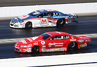 Nov 13, 2016; Pomona, CA, USA; NHRA pro stock driver Drew Skillman (near) alongside Allen Johnson during the Auto Club Finals at Auto Club Raceway at Pomona. Mandatory Credit: Mark J. Rebilas-USA TODAY Sports