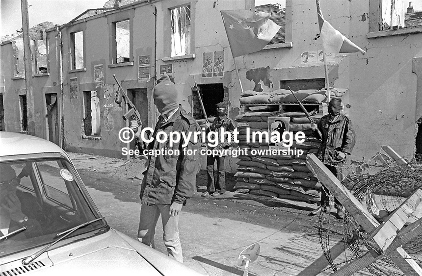 Provisional IRA members have set up a sandbag emplacement and checkpoint to regulate foot and vehicle traffic into and out of Free Derry, essentially the Bogside area of Londonderry. May 1972. 197205000294d<br />