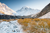 Fresh snow in Hooker Valley with Aoraki Mt. Cook 3724m at sunrise, highest mountain in New Zealand dominating skyline, Aoraki Mt. Cook National Park, Mackenzie Country, UNESCO World Heritage Area, New Zealand, NZ