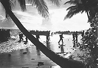 American troops of the 160th Infantry Regiment rush ashore from a landing boat during amphibious training here.  Guadalcanal, March 1, 1944.  Preston.  (Army)<br /> NARA FILE #:  111-SC-192796<br /> WAR &amp; CONFLICT BOOK #:  1172