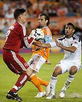 Houston Dynamo goalkeeper Pat Onstad makes the save as Dynamo defender Mike Chabala protects the ball from Sean Franklin of the Los Angeles Galaxy during the regular season game between the Los Angeles Galaxy and the Houston Dynamo at Robertson Stadium in Houston, TX on April 10, 2010. Los Angeles 2, Houston 0.