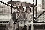 Williamsport, Pa, 1968. Three young girls with umbrella.