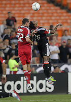 WASHINGTON, DC. - AUGUST 22, 2012:  Lionard Pajoy (26) of DC United heads back over  Austin Berry (22) of the Chicago Fire during an MLS match at RFK Stadium, in Washington DC,  on August 22. United won 4-2.