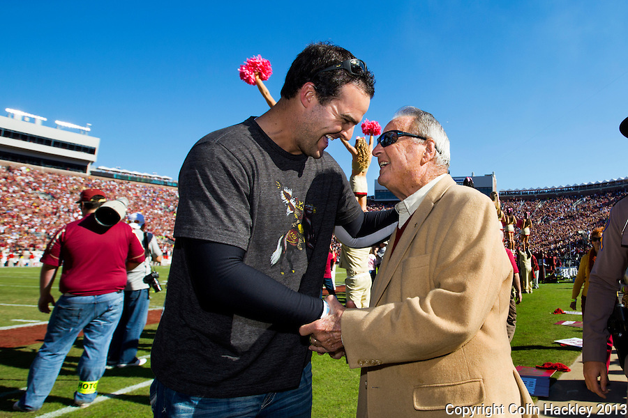 TALLAHASSEE, FLA. 10/26/13-FSU-NCSTATE102613CH-Former Florida State Head Coach Bobby Bowden talks with former player Matt Henshaw after a ceremony recognizing him prior to the N.C. State game Saturday at Doak Campbell Stadium in Tallahassee. <br /> COLIN HACKLEY PHOTO