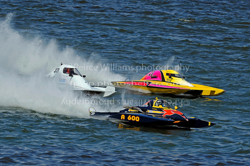 "Jim Aid, A-33 ""In Cahoots Again"", Mike Monohan, A-23 ""Geezerboat"" and Dan Kanfoush, A-600 ""Mr.Bud"" race to the first turn."