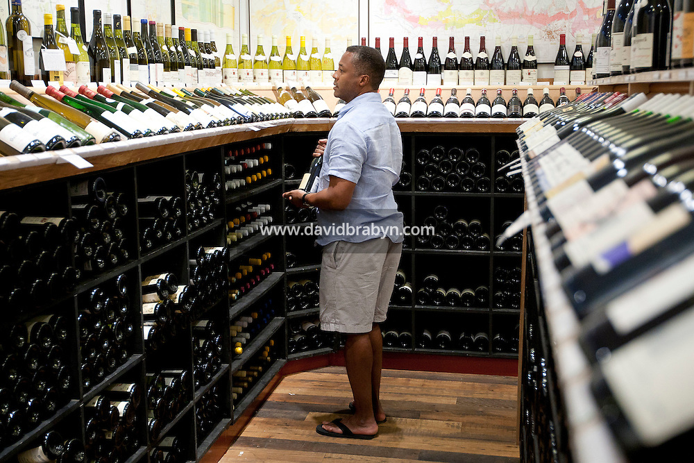 A man browses through wines on display at Chambers Street Wines in New York, NY, USA, 22 May 2009. The store specializes in naturally made wines from artisanal small producers and has received a Slow Food NYC Snail of Approval.