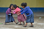 Girls play basketball during a recess from school in Tuixcajchis, a small Mam-speaking Maya village in Comitancillo, Guatemala.