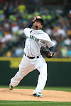 Seattle Mariners'  starting pitcher Felix Hernandez pitches to Los Angeles Angels Albert Pujols, striking him out in the first inning of  season home opener April 6, 2015 at Safeco Field in Seattle.  The Mariners beat the Angels 4-1.  ©2015. Jim Bryant Photo. ALL RIGHTS RESERVED.
