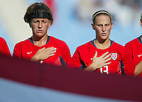 14 August 2004:  Joy Fawcett and Kristine Lilly during the national anthem at Kaftanzoglio Stadium in Thessaloniki, Greece.   USA defeated Brazil, 2-0. Credit: Michael Pimentel / ISI