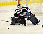 12 February 2011: University of New Hampshire Wildcat goaltender Kayley Herman, a Senior from Weyburn, Saskatchewan, makes a third period save on her way to a shutout against the University of Vermont Catamounts at Gutterson Fieldhouse in Burlington, Vermont. The Lady Wildcats defeated the Lady Cats 2-0 to split their Hockey East twin game weekend series. Mandatory Credit: Ed Wolfstein Photo