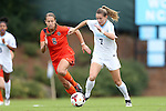 17 October 2013: North Carolina's Kealia Ohai (7) and Syracuse's Rachel Blum (6). The University of North Carolina Tar Heels hosted the Syracuse University Orangemen at Fetzer Field in Chapel Hill, NC in a 2013 NCAA Division I Women's Soccer match. UNC won the game 1-0.