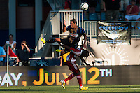 Daniel Cruz (44) of the Philadelphia Union goes over the top of Jair Benitez (5) of FC Dallas on a header. The Philadelphia Union and FC Dallas played to a 2-2 tie during a Major League Soccer (MLS) match at PPL Park in Chester, PA, on June 29, 2013.