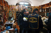 Rome 3 December 2007.Italien policemen of the Forest Guard employee to control of  international trade of plant's  and animals species protected  with agents of the Financial police seized  material from protected species in a  somali's store of district Equilino  .Ostrich eggs South Africa