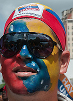 Venezuela: Caracas,15/07/12 supporter  of opposition candidate Henrique Capriles,with his face painted with a Venezuela flag colors, during a walk in San Martin Avenue in Caracas, in his election campaign for the upcoming presidential elections in Venezuela on October 7.Carlos Hernandez/Archivolatino