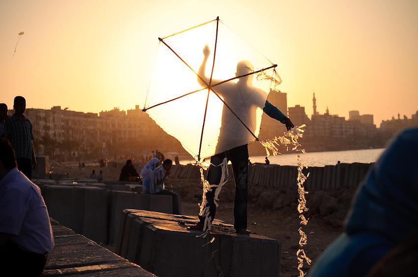 A kite flyer along the Corniche in Alexandria