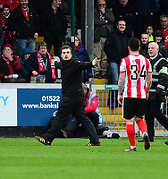 A York City fan gets onto the pitch celebrating the goal<br /> <br /> Photographer Andrew Vaughan/CameraSport<br /> <br /> Buildbase FA Trophy Semi Final Second Leg - Lincoln City v York City - Saturday 18th March 2017 - Sincil Bank - Lincoln<br />  <br /> World Copyright &copy; 2017 CameraSport. All rights reserved. 43 Linden Ave. Countesthorpe. Leicester. England. LE8 5PG - Tel: +44 (0) 116 277 4147 - admin@camerasport.com - www.camerasport.com