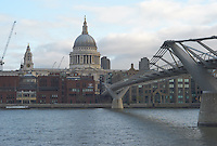 The London Millennium Footbridge, crossing the River Thames, with St. Paul's Cathedral in the distance.