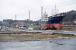 The 330-ton Kyotoku-maru fishing boat remains standing among the debris almost one year after it was washed 800 meters inland by the tsunami that hit Kesennuma, Miyagi Prefecture, Japan on 10 Mar 2011. The fate of the ship is still undecided as residents and leading community figures are debating the value of leaving it on land as a monument to the disasters, with local politicians saying maintenance costs could be in the 10s of millions of yen per year. Photographer: Robert Gilhooly