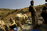 A Kurdish family prepares sheep wool for the market at a river by their home in central Iraqi Kurdistan...Stability and security prevail in postwar Iraqi Kurdistan as Iraqi tourists, many of them from Baghdad, flock to the northern cities and their amusement parks and national parks to escape violence and sectarian strife in the central and southern regions of the country.