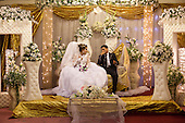 BAGHDAD, IRAQ: Hussein whispers to his wife, Hind, during their wedding...On January 22nd, 2012, an IED (Improvised Explosive Devise) detonated near an Iraqi Army base in Fallujah. Hussein Jamil Abdullah, a 28 year-old soldier from Baghdad was nearby when the explosive discharged, knocking him to the ground. Hey lay there for half an hour, his right leg in an jerry-rigged tourniquet made from a headscarf, before he was taken to hospital...Gangrene set in almost immediately and the doctors at Fallujah General Hospital had to amputate his leg. He was then moved to Adnan Hospital, the military medical center, but the care Hussein received was terrible. His bandage wasn'.t changed for two days and fearing that gangrene would set in a second time his family moved him to Kerkh Hospital, which they had to cover the costs themselves, as the army refused to pay...As soon as he was wounded, the Army cut Hussein.s salary in half: from $500 a month to $250, which is less than he can live on. His brother, Ali, has given up his work as a barber to take care of him, and his two other brothers, Abbas and Hassan, now take care of the family...Before he was wounded, Hussein, was to be engaged to his fianc&eacute;e, Hind and he had even bought and furnished a room in preparation. But, after the explosion, Hind.'s father refused to allow them to marry, saying that they can.t do so until Hussein gets a prosthetic leg...In the summer, a selection of photographs were published online and caught the attention of an NGO worker in Baghdad who arranged for Hussein to have a prosthetic leg fitted...Once he had his prosthetic leg, Hussein married Hind.