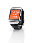 Samsung Galaxy Gear smartwatch with orange display closeup. Isolated watch on white background with clipping path.