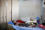 A young cancer patient lies in his bed at a hospital in Medical City on Sunday, October 24, 2010 in Baghdad, Iraq.